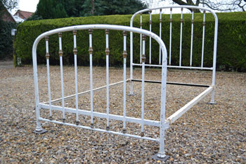 stylish french 4ft brass and iron bedstead lovely arched shape with brass rod ends and rows of brass spindles